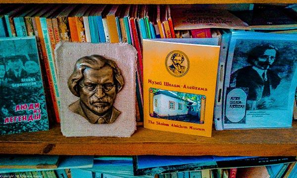 A book shelf at the Pereyaslav Jewish community center featuring books about Shalom Aleichem.
