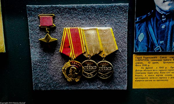 Walking through the Museum of the Great Patriotic War, many displays catalog military medals and valor.