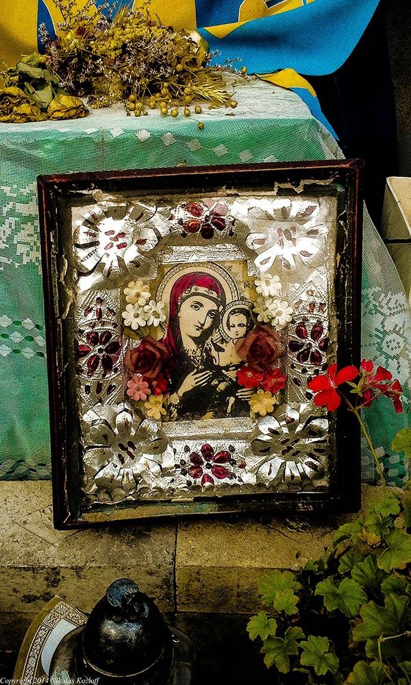 At mementos to the fallen around Maidan square, religion and politics mix.