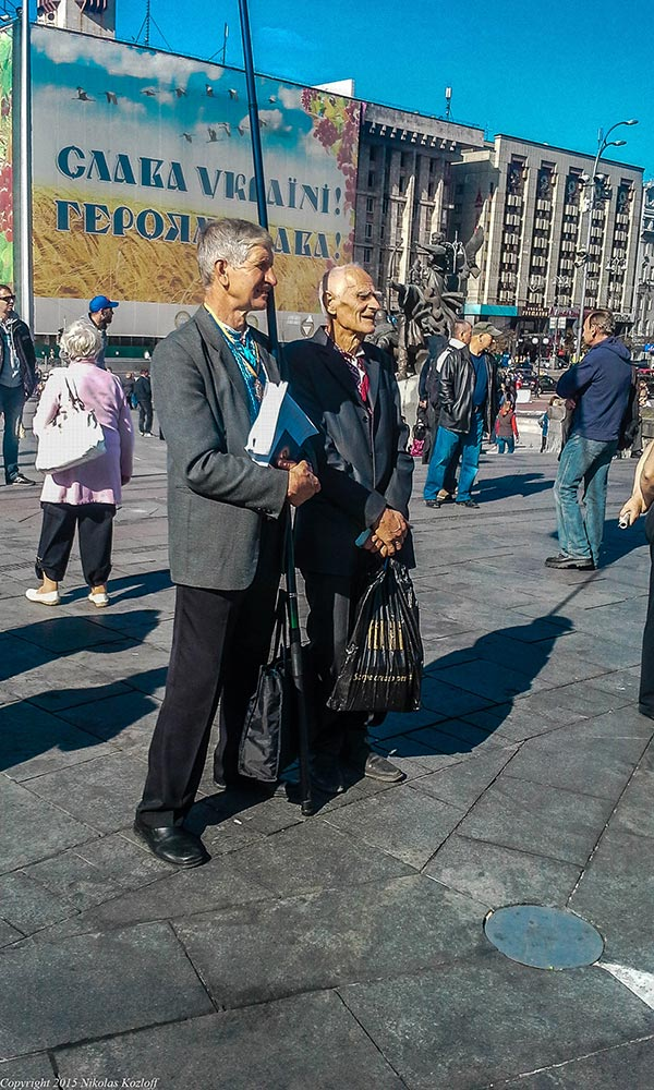 Elderly men take in the lustration rally.